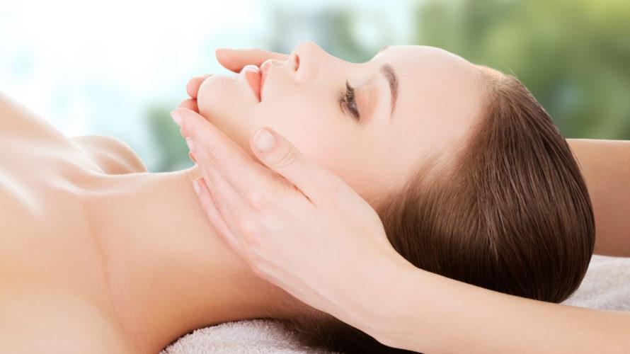 Woman receiving face massage.